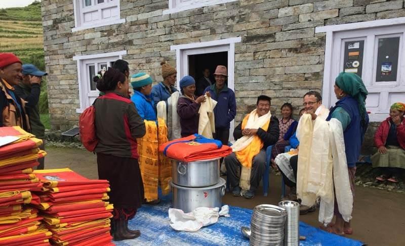 Donation at Khiraule Gompa